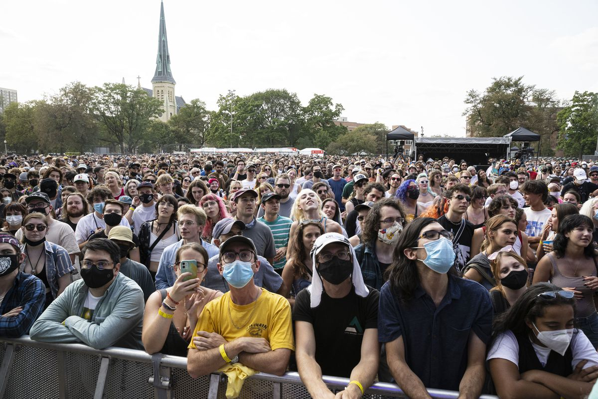 Concertgoers attend Pitchfork Music Festival earlier this month. Illinois' COVID-19 case numbers are down to the lowest levels seen in two months.