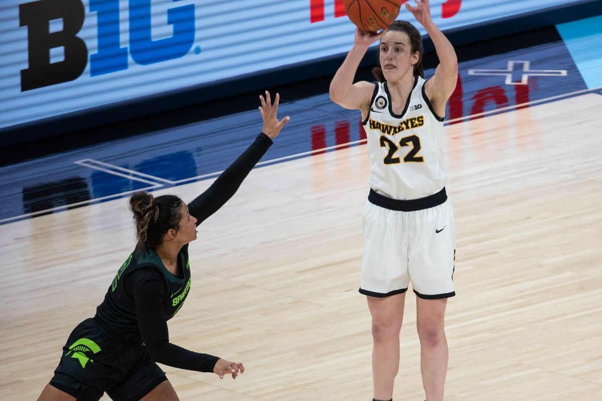 Iowa Hawkeyes guard Caitlin Clark shoots the ball while Michigan State Spartans guard Moira Joiner defends in the fourth quarter at Bankers Life Fieldhouse.