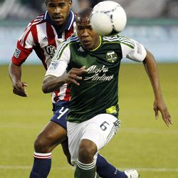 Portland Timbers' Darlington Nagbe races Chivas USA's Rauwshan McKenzie to the ball in the first half of an MLS soccer match, Saturday, April 7, 2012, in Portland, Ore.