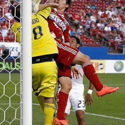FRISCO, TX - APRIL 25:  Zach Loyd #17 of the FC Dallas collides with goal keeper Nick Rimando #18 of the Real Salt Lake at FC Dallas Stadium on April 25, 2012 in Frisco, Texas.  (Photo by Tom Pennington/Getty Images)