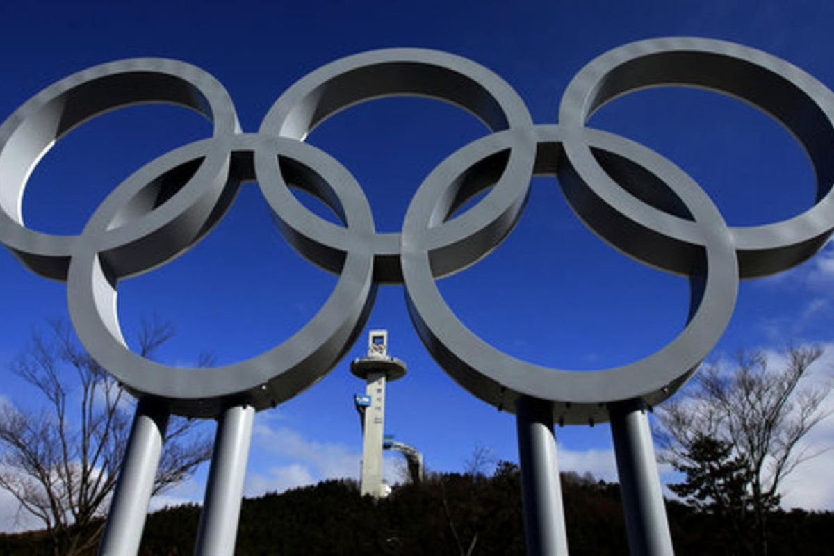 The tower for the Alpensia Ski Jumping Center rises beyond a set of Olympic Rings at the 2018 Winter Olympics in Pyeongchang, South Korea, Friday, Feb. 2, 2018.