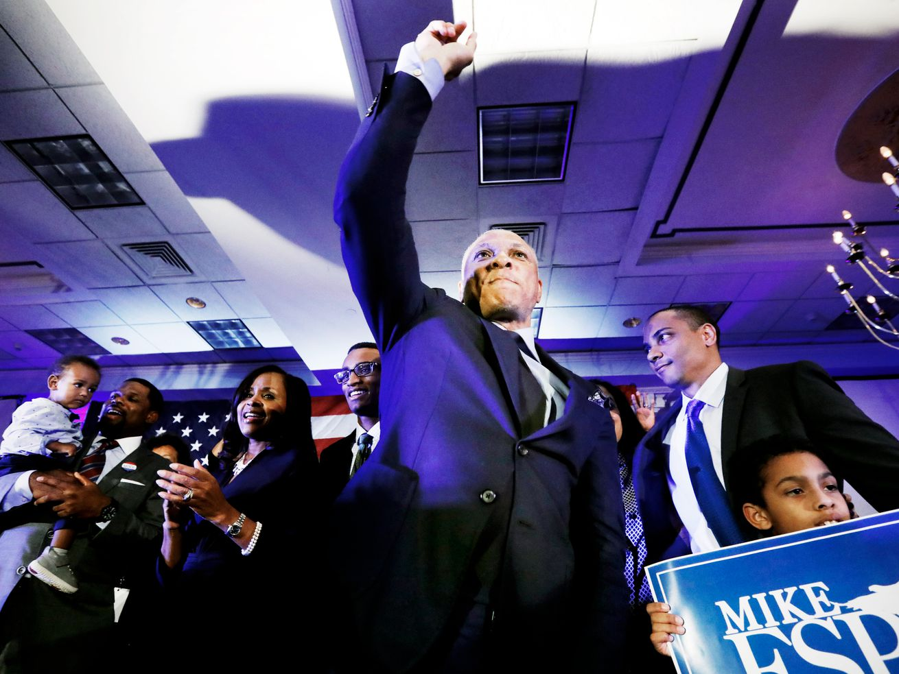 Democratic candidate Mike Espy stands with family members and supporters on election night in Jackson, Mississippi on November 6, 2018.