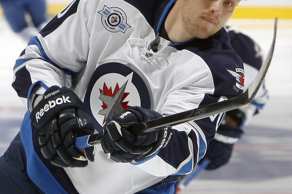 TORONTO, CANADA - OCTOBER 19: Nik Antropov #80 of the Winnipeg Jets shoots during warmup before NHL action at the Air Canada Centre October 19, 2011 in Toronto, Ontario, Canada. (Photo by Abelimages/Getty Images)