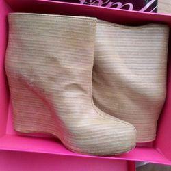 Margiela woodgrain booties, $219, Off Fifth