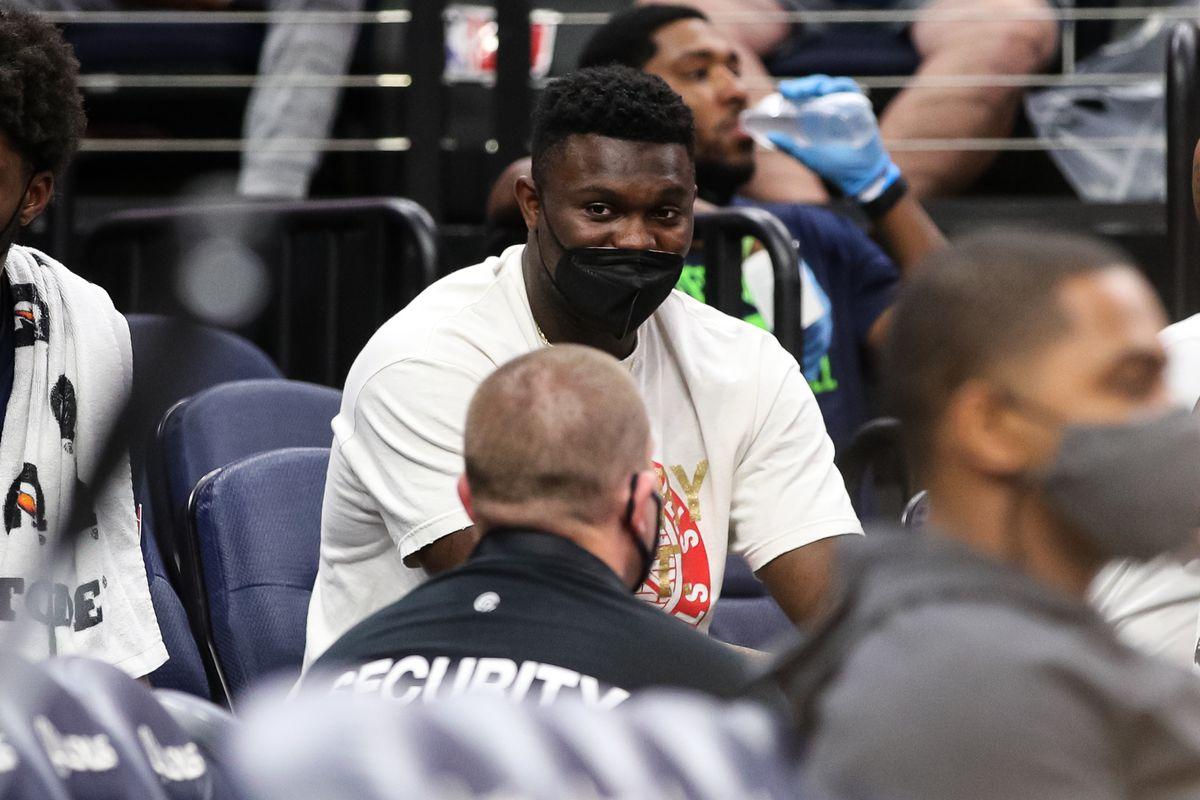 Zion Williamson #1 of the New Orleans Pelicans looks on from the bench in the fourth quarter of a preseason game against the Minnesota Timberwolves at Target Center on October 4, 2021 in Minneapolis, Minnesota. The Timberwolves defeated the Pelicans 117-114.