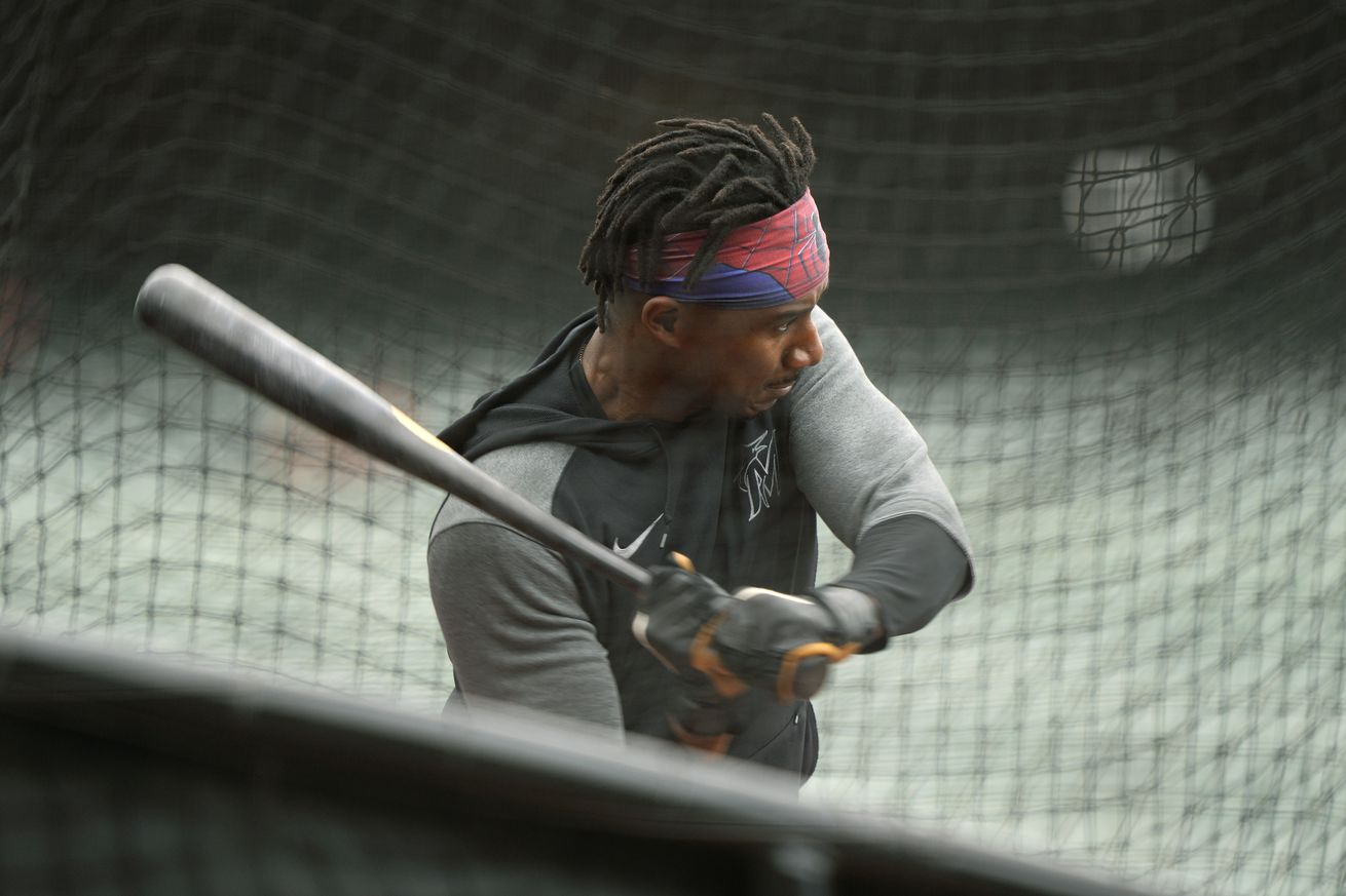 Lewis Brinson #25 of the Miami Marlins takes batting practice prior to the start of his game against the San Francisco Giants at Oracle Park on April 24, 2021 in San Francisco, California.