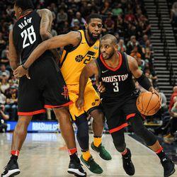 Houston Rockets guard Chris Paul (3) uses forward Tarik Black (28) to screen out Utah Jazz forward Royce O'Neale (23) as the Utah Jazz host the Houston Rockets at Vivint Smart Home Arena Salt Lake on Thursday, Dec. 7, 2017.