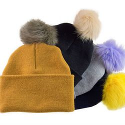 """Beaker Fox Fur PomPom Beanie, <a href=""""http://ingodwetrustnyc.com/collections/womens/products/igwt-beaker-pom-pom-beanie"""">$66</a> at <b>In God We Trust</b>"""