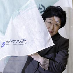 Han Myeong-sook, chairwoman of main opposition Democratic United Party comes out after casting her vote for the parliamentary election at a polling station in Seoul, South Korea, Wednesday, April 11, 2012.