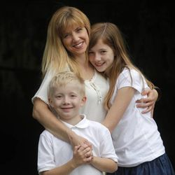 Anne Hamming hugs her kids, Lee, 9, and Katie, 11. Hamming, from Grand Rapids, Mich., had to do some juggling with her ex-husband when Lee was diagnosed with a very serious autoimmune disease.