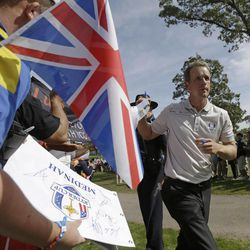 Europe's Luke Donald makes his way to the eighth hole during a practice round at the Ryder Cup PGA golf tournament Wednesday, Sept. 26, 2012, at the Medinah Country Club in Medinah, Ill.
