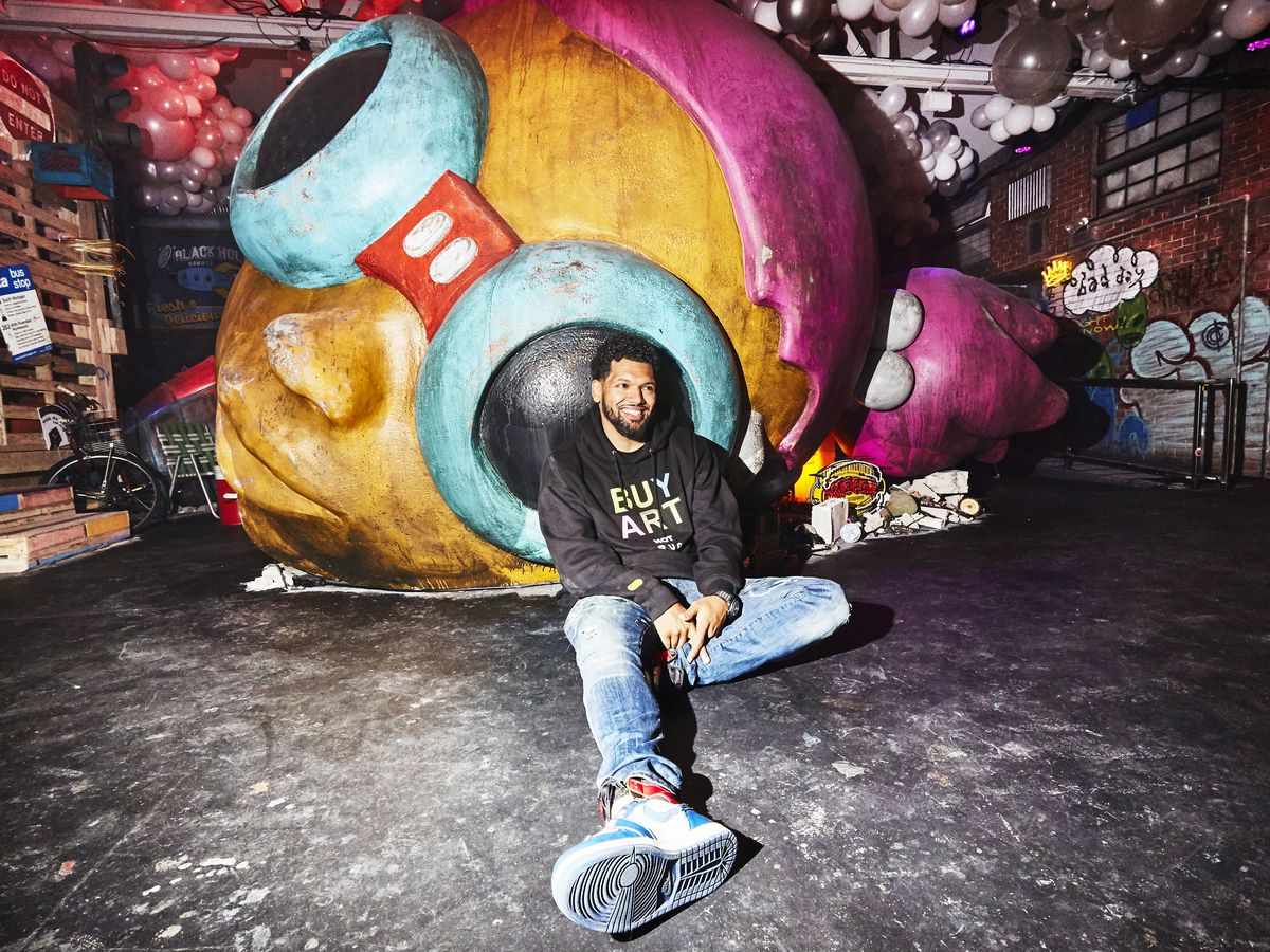 "Hebru Brantleys sits inside his new installation, ""Nevermore Park,"" opening Oct. 24."