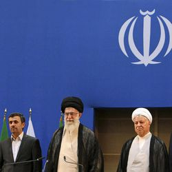 In this photo taken on Thursday, Aug. 30, 2012, and released by an official website of the Iranian supreme leader's office, supreme leader Ayatollah Ali Khamenei, center, parliament speaker Ali Larijani, right, chief of Expediency Council, Akbar Hashemi Rafsanjani, second right, President Mahmoud Ahmadinejad, second left, and judiciary chief Sadeq Larijani, left, listen to Iran's national anthem, at the opening session of the Nonaligned Movement, NAM, summit, in Tehran, Iran.