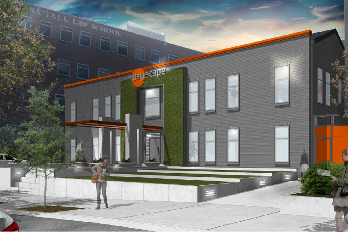 Two-story grey building with orange and green accents and a stepped lawn to the sidewalk.