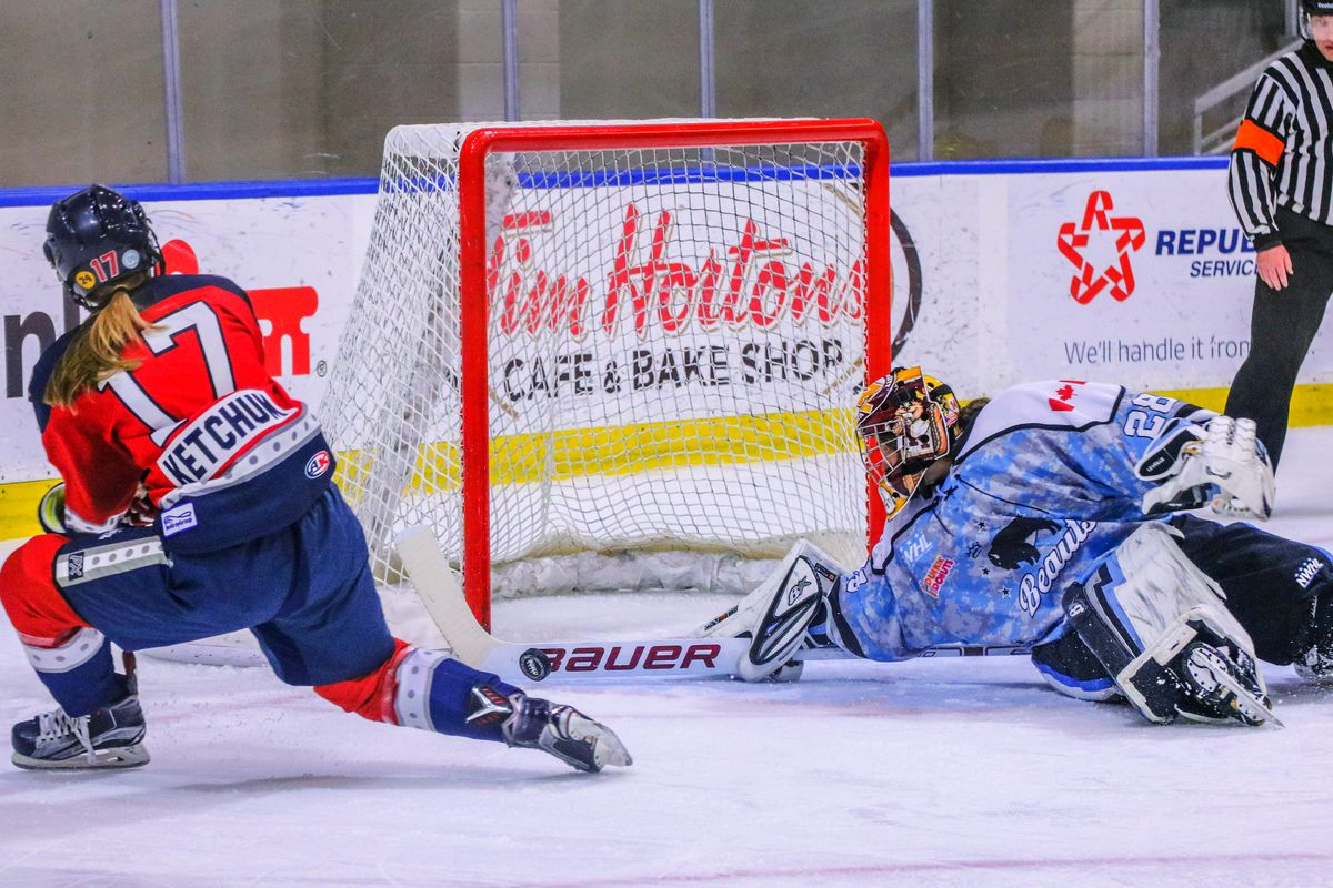Amanda Leveille (28) of the Buffalo Beauts makes a save on Bray Ketchum (17) of the New York Riveters