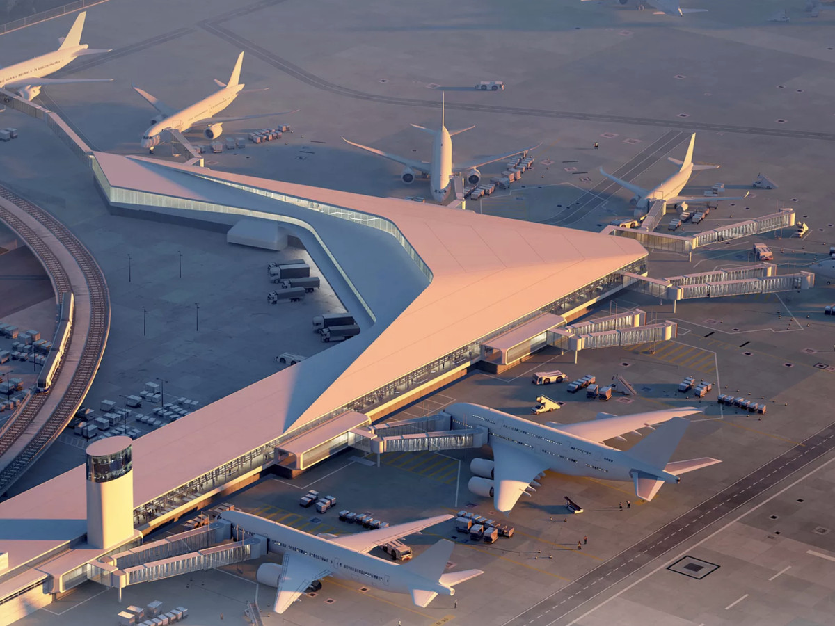 An aerial image of an angular airport terminal with large jets connected to the runway.