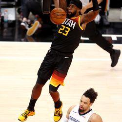 Utah Jazz forward Royce O'Neale (23) dunks over Memphis Grizzlies forward Dillon Brooks (24) as the Utah Jazz and the Memphis Grizzlies play in game 5 at Vivint Arena in Salt Lake City on Wednesday, June 2, 2021. Utah won 126-110, Utah advances to the second round.