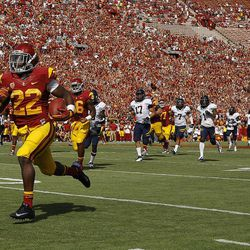 Southern California running back Curtis McNeal, left, runs with the ball during the first half of an NCAA college football game against California in Los Angeles, Saturday, Sept. 22, 2012.