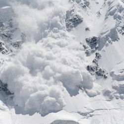 A skier survived a close call with an avalanche (not pictured) after deploying an air bag while sliding down a mountainside Friday, officials confirmed.