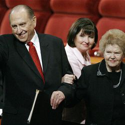 LDS Church President Thomas S. Monson acknowledges conference attendees as he and his wife, Frances, leave the Conference Center in Salt Lake City after the Sunday morning session of the 179th Semiannual General Conference of The Church of Jesus Christ of Latter-day Saints.
