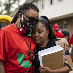 Jacob Blake's uncle, Justin Blake, hugs a supporter during a community event hosted by the Blake family on the block where Jacob Blake was shot in the back by a Kenosha police officer, Tuesday morning, Sept. 1, 2020. President Donald Trump is scheduled to visit Kenosha Tuesday afternoon to meet with local officials and survey areas affected by the unrest in the wake of the shooting.