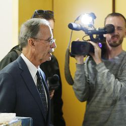 """FILE""""""""Salt Lake County Recorder Gary Ott is followed by media after meeting with the Salt Lake County Council in Salt Lake City on Tuesday, Oct. 4, 2016. The council reviewed an audit of the county recorder's office."""