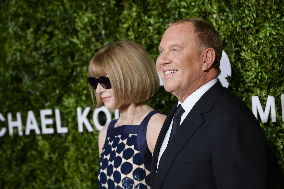 68be0a3b53a5 Michael Kors and Vogue editor Anna Wintour pose on the red carpet at a  charity event in New York City in 2016.