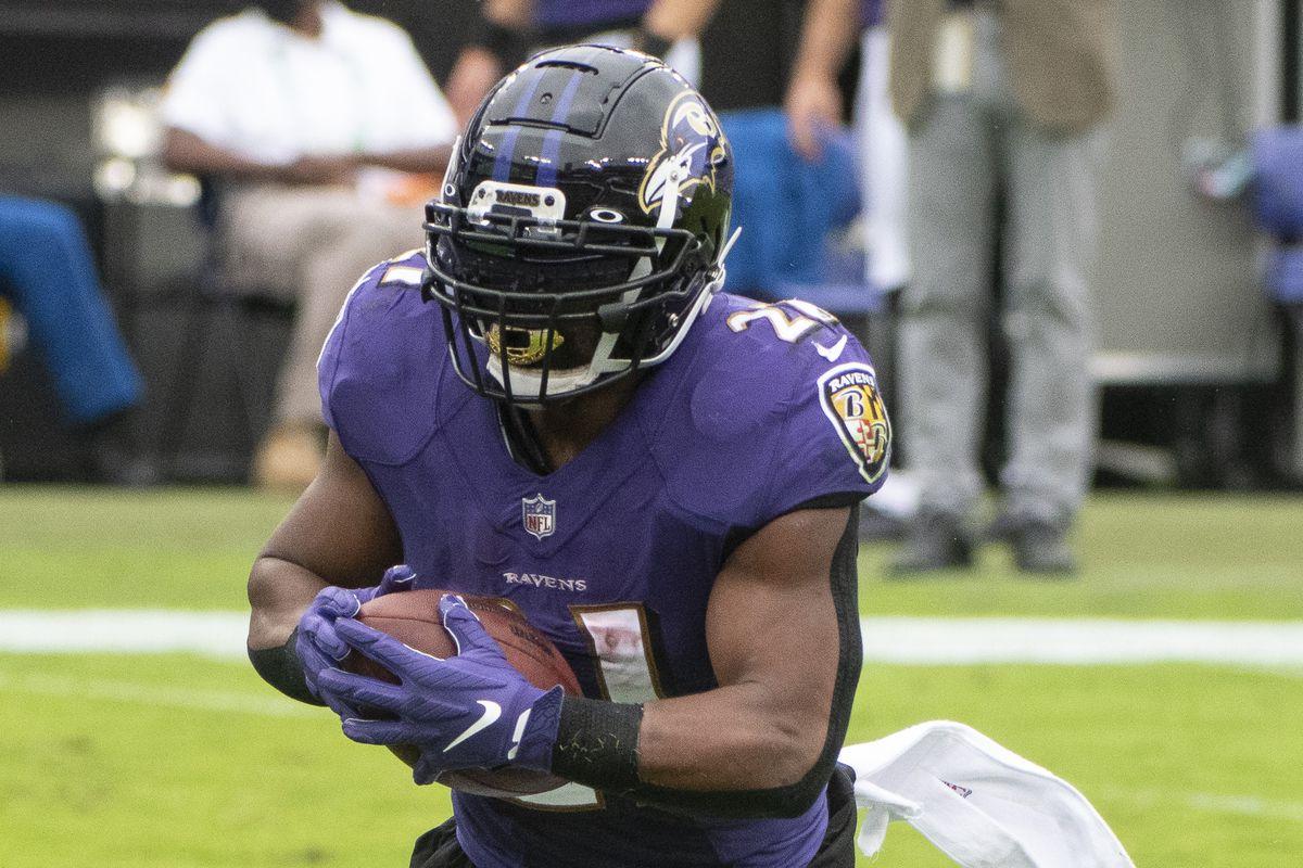 Baltimore Ravens running back Mark Ingram (21) rushes during the game against the Cincinnati Bengals at M&T Bank Stadium.