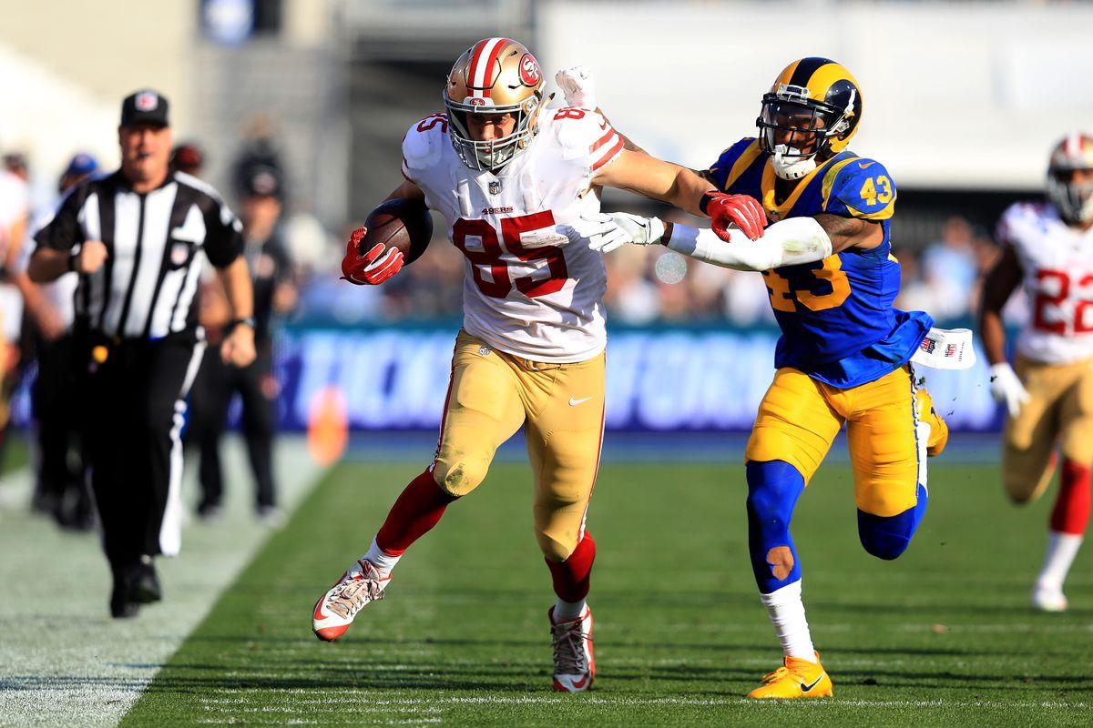 Los Angeles Rams S John Johnson chases San Francisco 49ers TE George Kittle