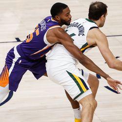Utah Jazz forward Bojan Bogdanovic (44) protects the ball against Phoenix Suns forward Mikal Bridges (25) during an NBA preseason game at Vivint Smart Home Arena in Salt Lake City on Saturday, Dec. 12, 2020.