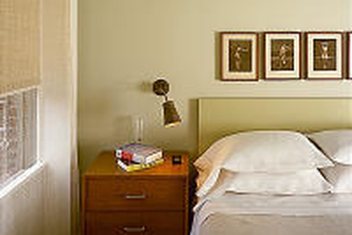 A light mounted near a bed, like this Bakelite lamp, gives a nighttime reader his or her own spotlight. Sconces can also be installed to illuminate a dark hallway.