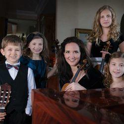 The family orchestra: Matthew (classical guitar), Sara (cello), Jenny (violin), Laura (violin) and Hannah (piano)