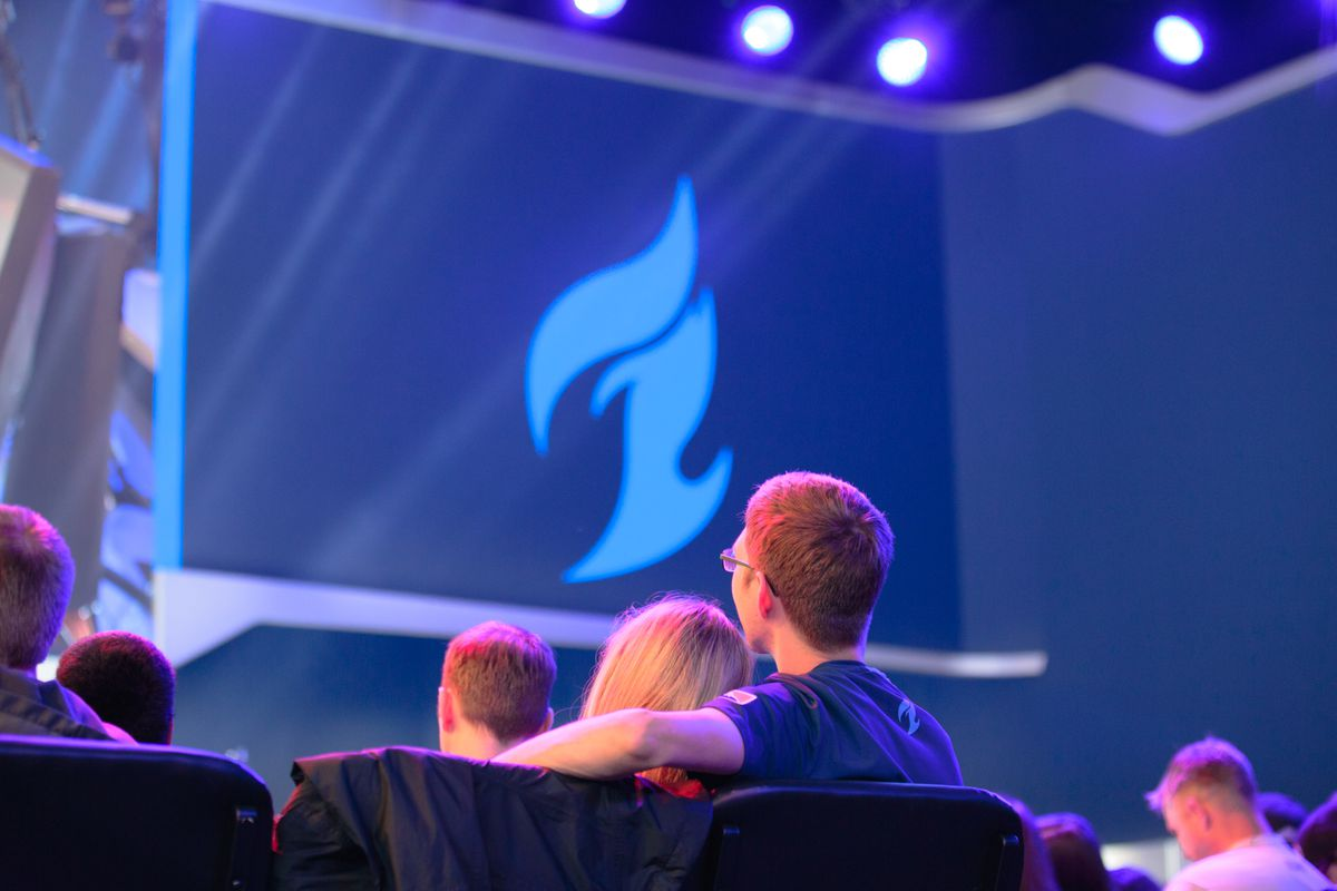 Two fans watch the Dallas Fuel play at the Blizzard Arena