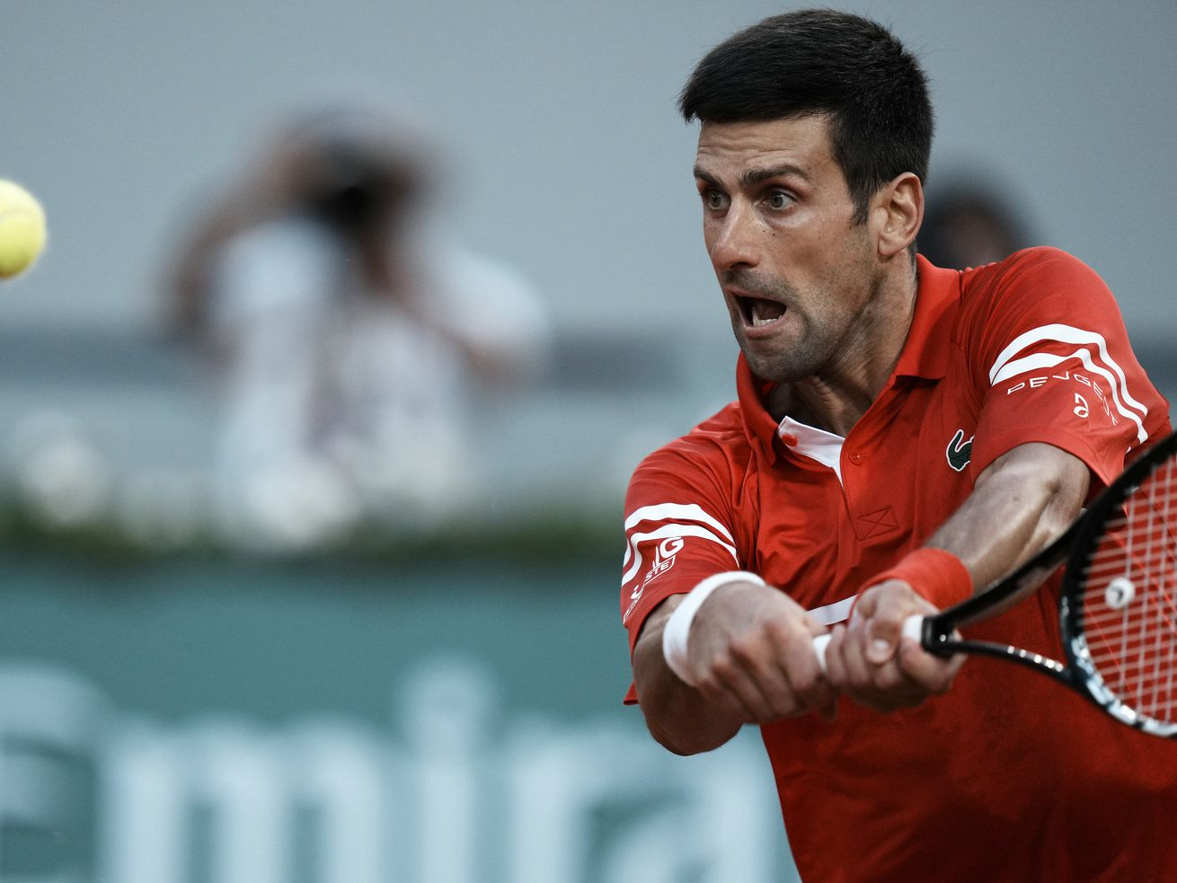 Serbia's Novak Djokovic returns the ball to Spain's Rafael Nadal during their semifinal match at the French Open.