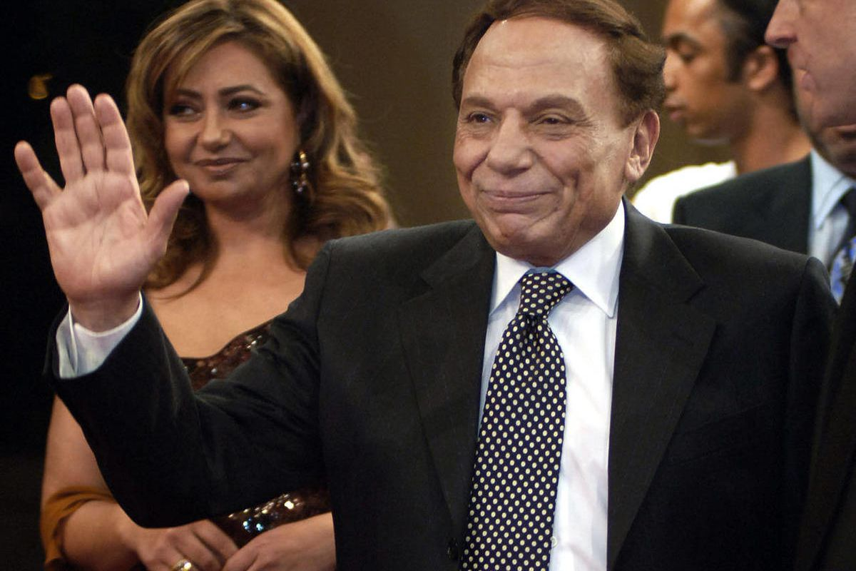 FILE - In this Sunday, Nov. 11, 2005 file photo, Egyptian film actor and comedian Adel Imam, right, walks with Egyptian actress Laila Elwi, left, during the Second Dubai International Film Festival red carpet reception in Dubai, United Arab Emirates. An E