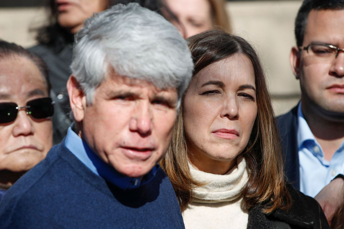 Former Illinois governor Rod Blagojevich (L) speaks outside his house on Feb. 19 after President Donald Trump commuted his sentence for corruption.