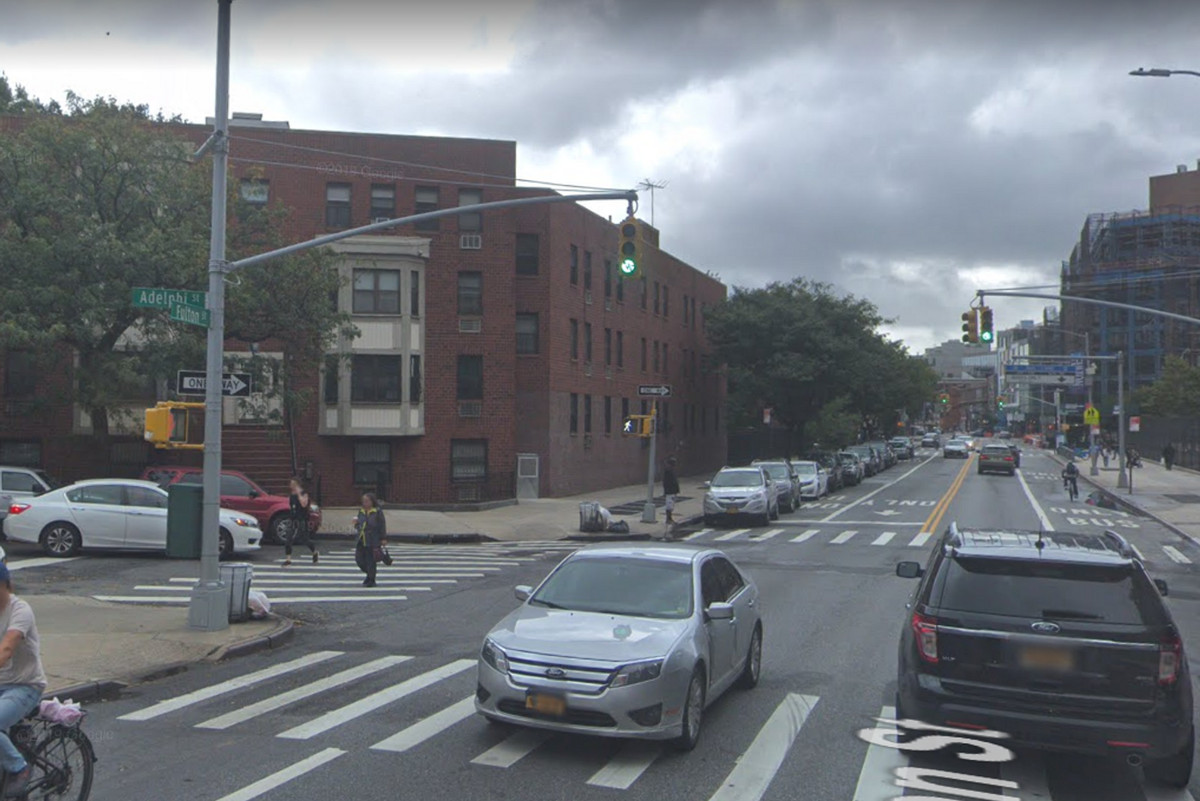 This Google Maps image from October 2018 shows the now-gone crosswalk signal (left) at Fulton and Adelphi Streets in happier times.