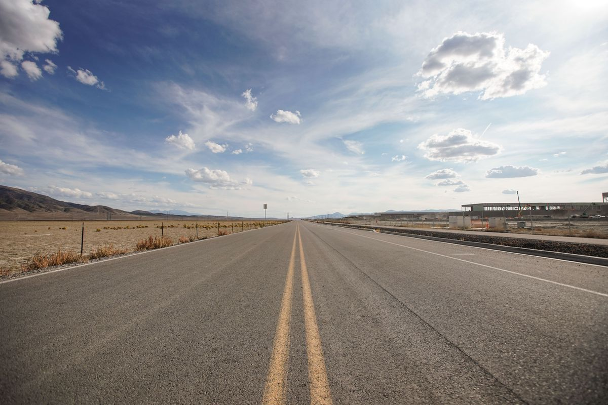 The Pony Express Parkway runs past land Google has purchased for a potential data center, left, and a Facebook data center under construction, right, in Eagle Mountain on Monday, Oct. 4, 2021.