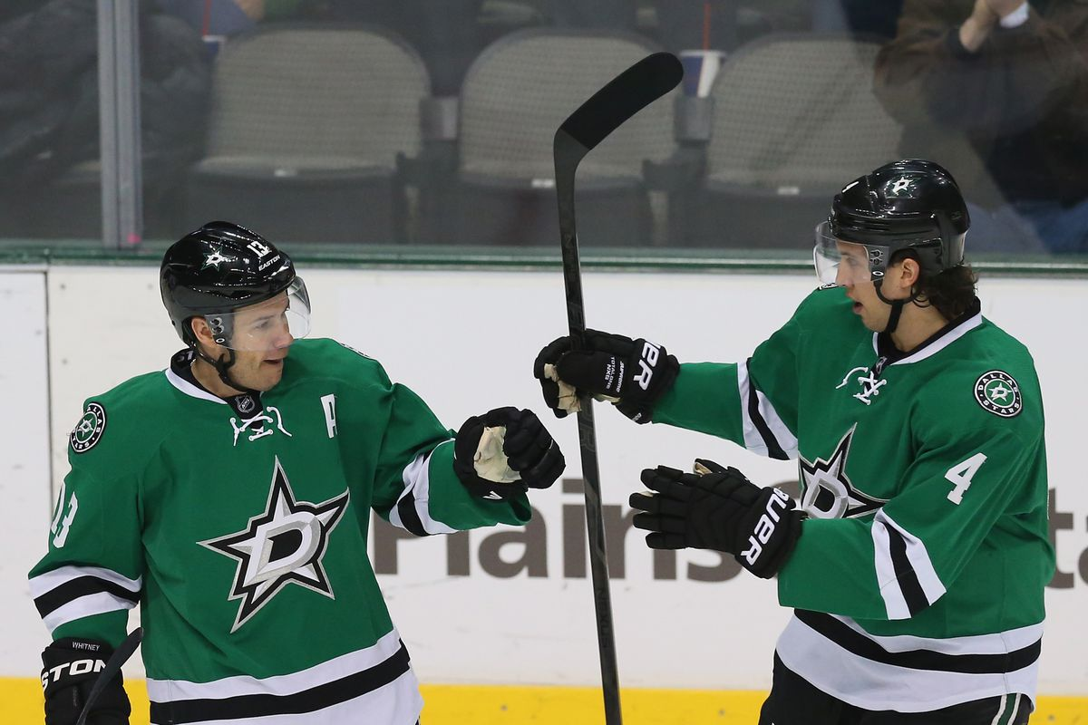 Pictured: Ray Whitney and Brenden Dillon practice passing the torch