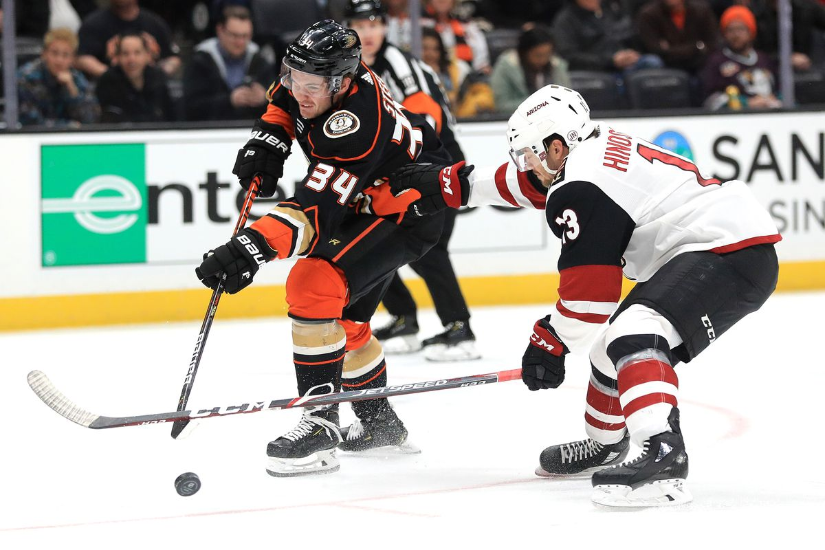 Sam Steel #34 of the Anaheim Ducks shoots the puck past Vinnie Hinostroza #13 of the Arizona Coyotes during the third period of game at Honda Center on January 29, 2020 in Anaheim, California.
