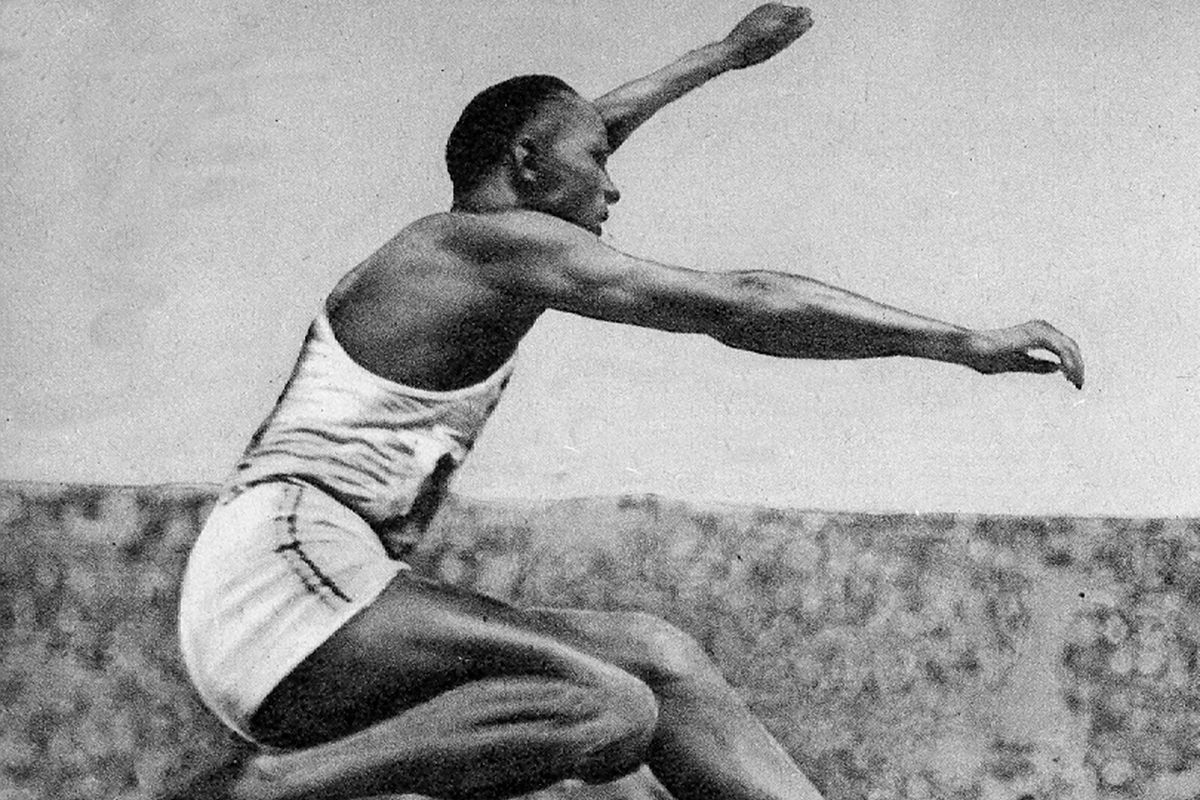 Jesse Owens (1913 - 1980) American track and field athlete. He participated in the 1936 Summer Olympics in Berlin, Germany, where he achieved international fame by winning four gold medals: one each in the 100 meters, the 200 meters, the long jump, and as...