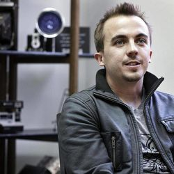 ADVANCE FOR WEEKEND EDITIONS APRIL 14-15 - In this April 6, 2012 photo, actor Frankie Muniz, left, sits with members of  the pop rock band Kingsfoil in York, Pa.