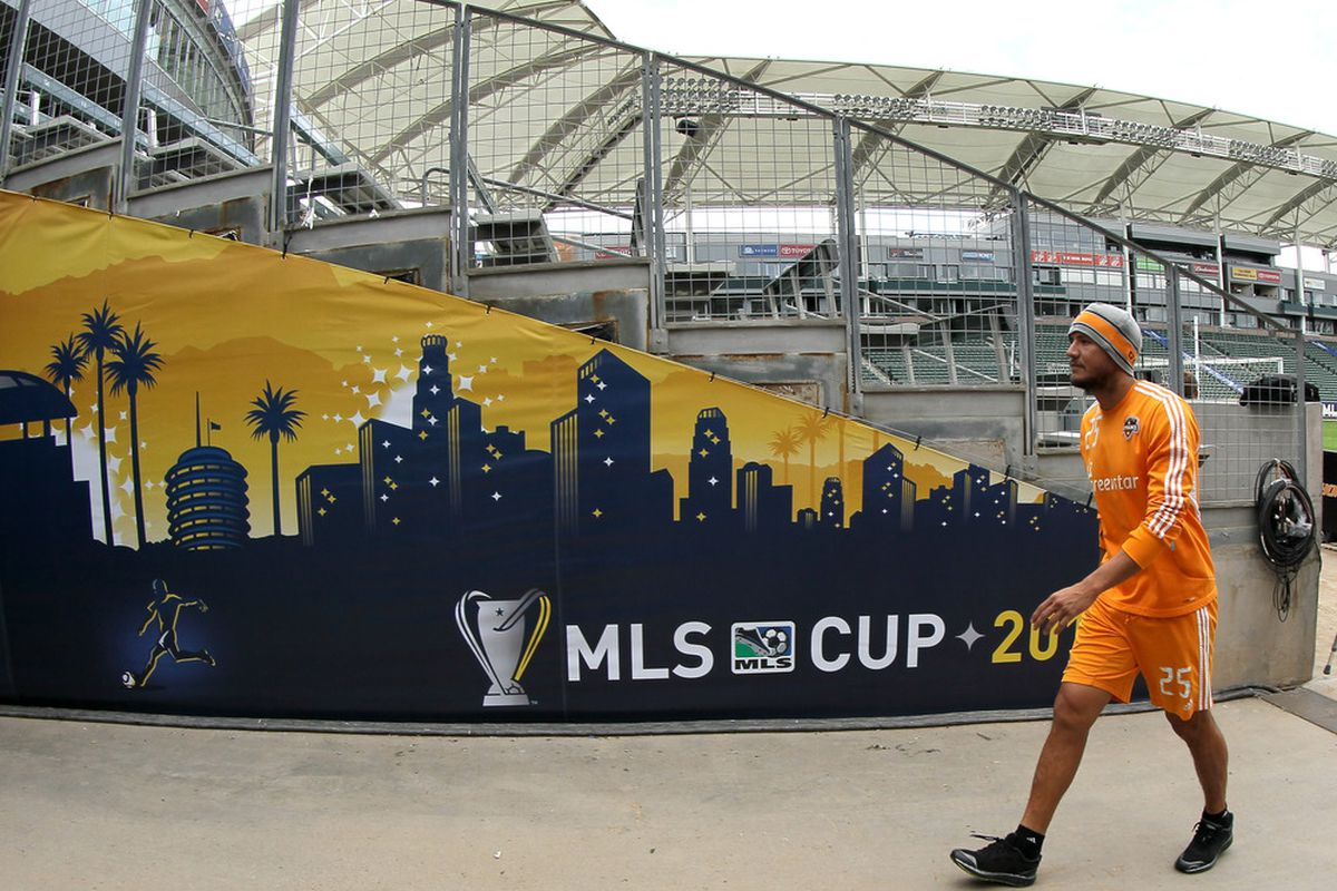 CARSON, CA - NOVEMBER 19: Brian Ching #25 of the Houston Dynamo leaves the field following a training session ahead of the MLS Cup at The Home Depot Center on November 19, 2011 in Carson, California.  (Photo by Stephen Dunn/Getty Images)