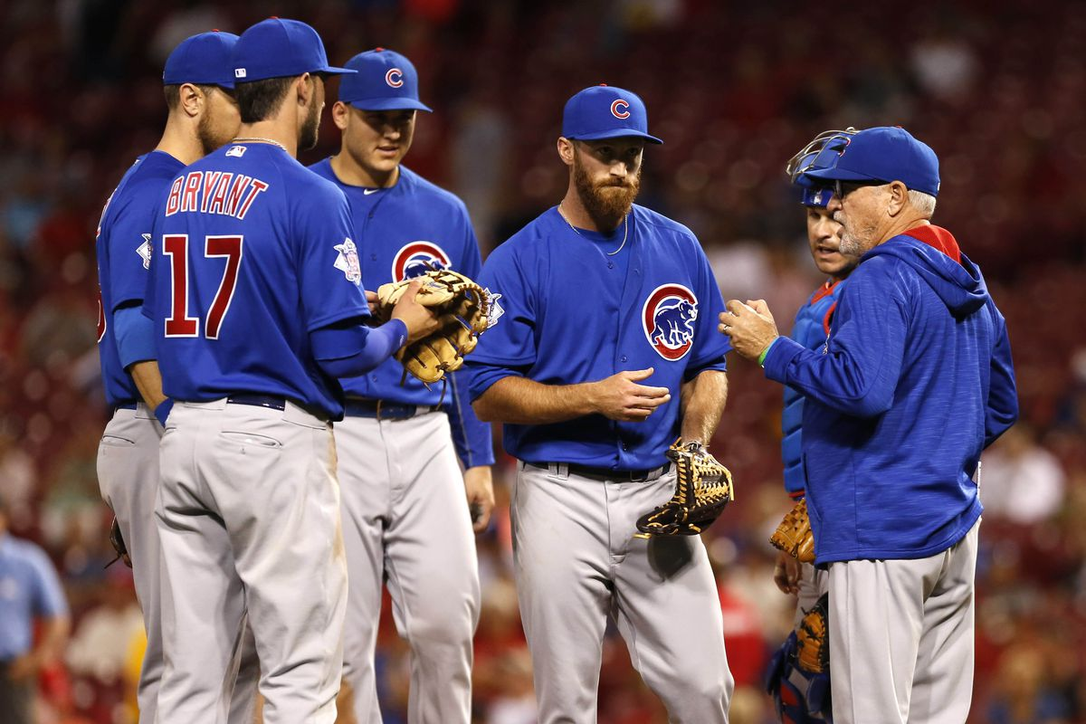 Professor Maddon conducting class on the mound Tuesday evening