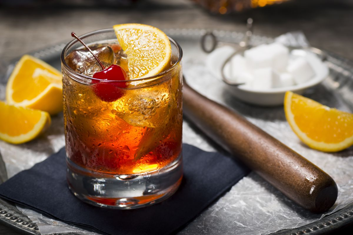 A view of an old fashioned with orange slices