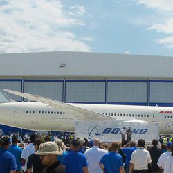 Boeing workers work gather around a 787 at the company's assembly plant in North Charleston, S.C., on Friday, April 27, 2012. The plane, rolled out Friday, is the first 787 manufactured at the company's South Carolina plant that opened last year.