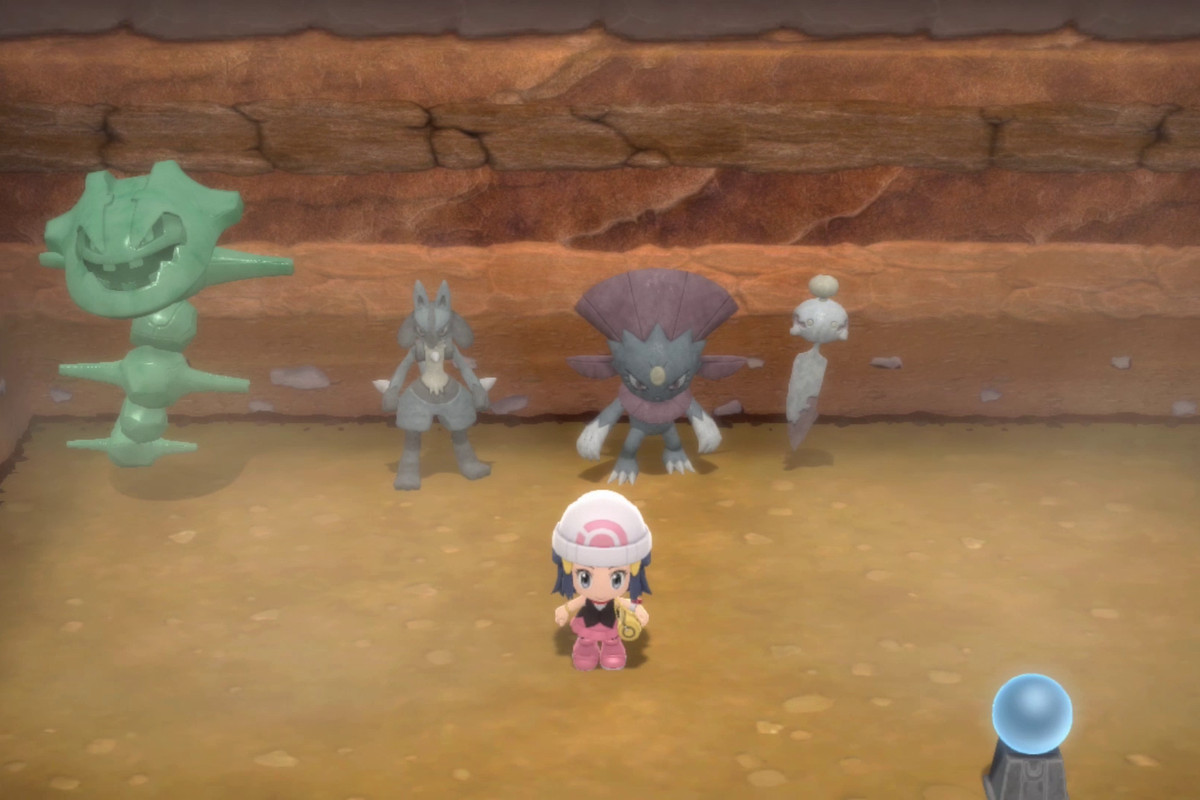 dawn, from pokemon diamond and pearl, sitting in a dirt room filled with pokemon statues