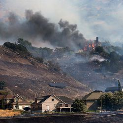 A home burns at the mouth of Weber Canyon on Tuesday, Sept. 5, 2017.