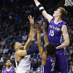 Portland Pilots center Philipp Hartwich (15) blocks the shot by Brigham Young Cougars forward Yoeli Childs (23) in Provo on Thursday, Dec. 28, 2017.