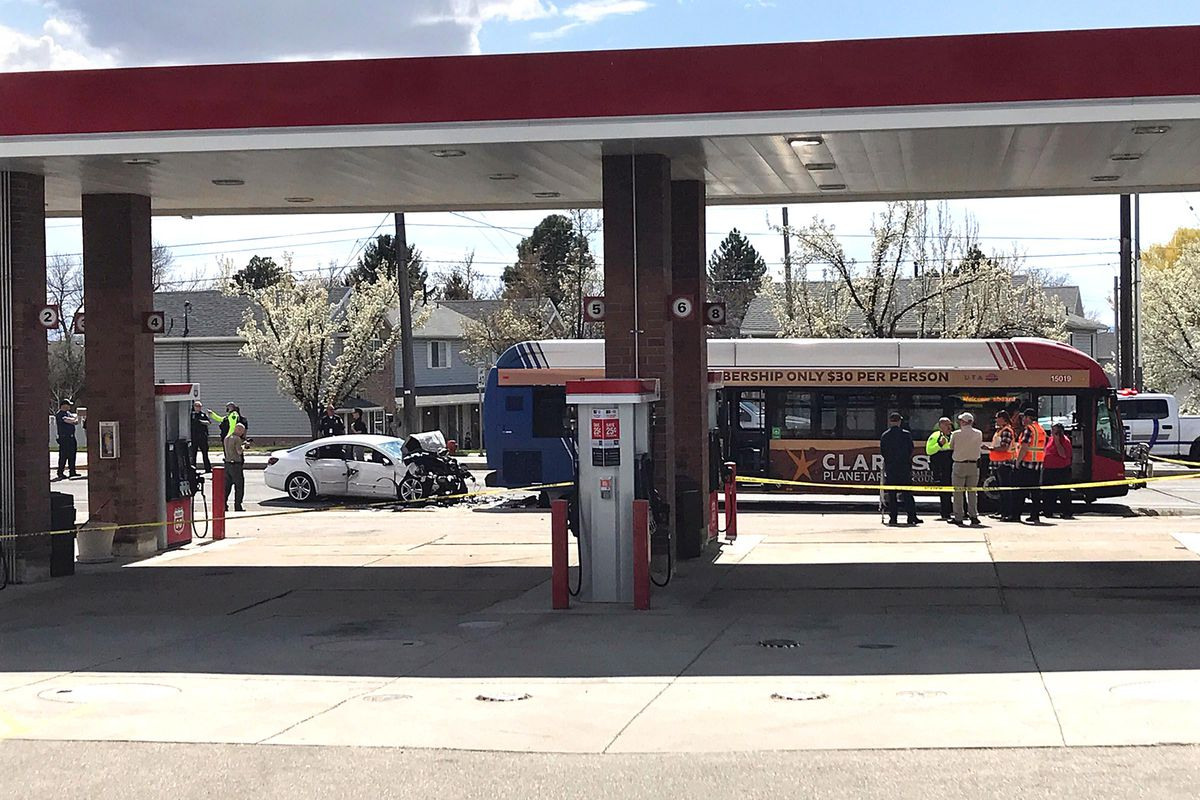 Police respond after a car crashed into the back of a UTA bus at100 South Main in Kaysville, killing the driver, on Tuesday, April 7, 2020. Another person was taken to a local hospital to be checked for injuries that were not life-threatening.